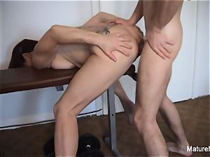 Pierced granny gets an ass-fuck workout in the gym
