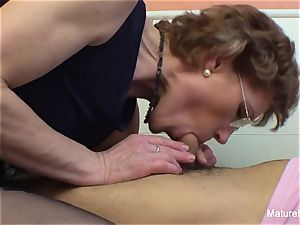 Mature breezy with glasses enjoys getting pummeled