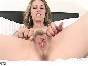 Izzy uses a vibro to cum rigid