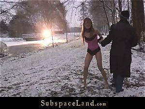 Sever master tortures victim Olga Barz out in the cold