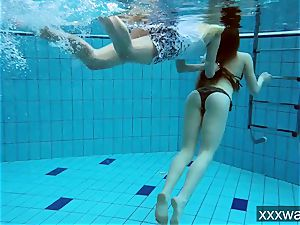 steaming Russian ladies swimming in the pool