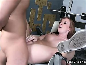 red haired bimbo gets boned rigid in the gym