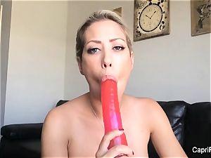 Capri plays with her gigantic dildo