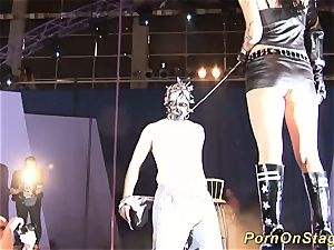 horny fetish needle demonstrate on stage