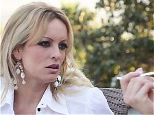 Stormy Daniels deep-throats off a stranger in the back seat