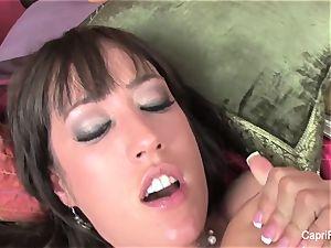 huge-boobed Capri Cavanni pummels on the bed